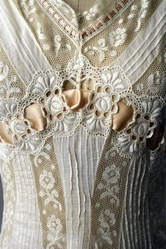 A detail of a 1908 princess slip.  Catching a glimpse of a frilly bit like this was probably on the mind of many an Edwardian man.