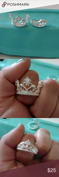 Size 7 sterling silver crown ring lot Both genuine sterling silver crown rings. Princess style crown. Both fit a size 7. Very nicely made and adorned with crystal stones. Jewelry Rings