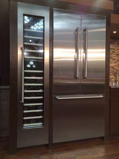 Wine cooler next to refrigerator