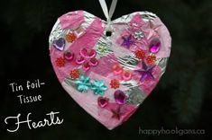 TIN FOIL-TISSUE HEARTS: simple but beautiful Valentines ornaments for preschoolers to make.  We LOVED making these!  HOW TO HERE
