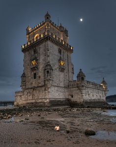Tower of Belem lighted by the Moon. Photographer: nybcn. Santa Maria de Belem, Lisbon, Portugal. The tower was commissioned by King John II to be part of a defense system at the mouth of the Tagus river and a ceremonial gateway to Lisbon.