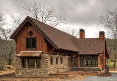 A 1,757 sq. ft. Mountain Rustic house, Plan 8504-00029 features 3 bedrooms, 2 bathrooms, a loft, and a 2 car garage.