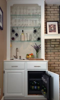 Built In Wet Bar - I converted a mirror-backed book shelf into a built in bar. The key pieces are: Summit Appliance 1.06 ft^3 Mini Refrigerator* (Home Depot). Sterling Drop-In Stainless Steel Bar Sink and Moen Anabelle Stainless 1-Handle Bar Faucet (Lowe's). *Note: Small return air grilles are installed in the top and side of the cabinet to provide adequate air flow for the mini fridge.