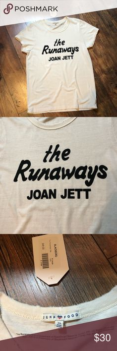 Junk Food The Runaways Joan Jett NWT t-shirt Junk Food The Runaways Joan Jett NWT t-shirt. Cream shirt with black lettering. Perfect condition. Size XL Junk Food Tops Tees - Short Sleeve