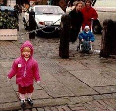 I saw this a long time ago. The lady standing in black by the stroller doesn't have any legs. The person who took the photo said that the lady ion black wasn't there at the time the photo was taken.