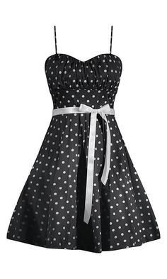 This little a-line, polka dot dress has a beautiful fit! Smocking in the back and a ruched bust makes an impeccable look. Ribbon tie at waist and lined with tooled skirt giving a full look. • 90% Cott