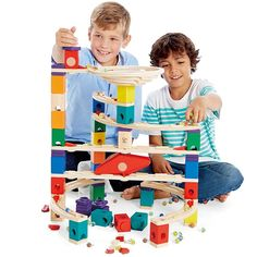This Quadrilla marble raceway construction toy comes with 136 building parts including a spiraling funnel, a mix of straight and curved rails, and 10 accelerators to challenge young builders in new directions and dimensions.