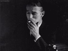 """Charles Chaplin (1927). Charlie gave up smoking in the early 1940's, There is similar gif but that one he appears very sad, this one appearing in a better mood. This appears to be 1927 (this was a very tumultious time in his life, he was going through a bitter divorce and some other personal issues at this time and had lost some weight) his hair is dyed black for """"The Circus"""" which was in production at this time (at this point he was gray - actually started going gray in his early 30's). A…"""