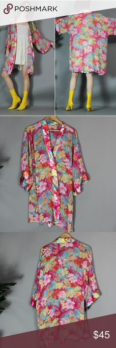 """Vintage 80s 90s Sheer Floral Short Robe Listed price firm, no offers please. Had & loved this little beauty for a few years - was always my go-to resort-y poolside cover-up. Perf for travel- packs nicely.  Semi sheer. Prettiest tropical lush flora print. no fabric/size tags. feels like polyester. has interior ties but no sash/belt.  Approximate meas: armpit 26"""" across length 35"""" Easy open fit making it a great gift for your bestie, mom, your hostess or yourself.  boho hippie kimono holiday…"""