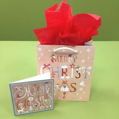 Need something quick and easy? Our gift bags will do the trick! This display features Merry Christmas gift bag, tissue paper and Merry Christmas (Kraft) Christmas card. Christmas Gift Bags, Christmas Cards, Merry Christmas, Stationery Companies, Matching Cards, Note Cards, Wraps, Greeting Cards, Tissue Paper