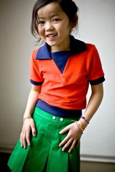 green kickpleat skirt w/ white buttons