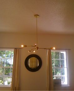 Lindsey Adelman :: Chandelier using stainless and brass........