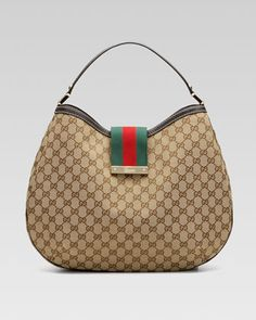 New Ladies Web GG Hobo Bag, Large by Gucci at Neiman Marcus. $960 15 x 14 I thought this was the ugliest bag but with denim its starting to grow on me...weird.
