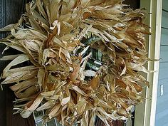 DIY: Corn Husk Wreath using a coat hanger, twine, & husks! pretty simple! {note to self: supplement home-grown husks w/dried husks in Mexican food aisle at the grocery store..then adorn wreath with wired on mini Indian Corn or pine cones}
