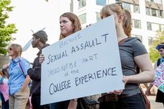 Demonstrators protest sexual assault on college campuses at the #YesAllWomen rally in solidarity with those affected by violence in Seattle on May 30, 2014.