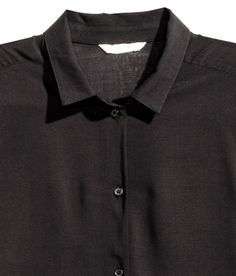 Check this out! Long, straight-cut shirt in airy, woven viscose fabric. Narrow collar, buttons at front and at cuffs, and slits at sides. - Visit hm.com to see more.