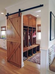 "DIY Barn Door Track Tutorail Good idea, and stylish for a rustic home too! ""mudroom – love the barn style door so you can close it off if you need to but leave it open most the time without some door in the way!"" @ DIY Home Design Style At Home, Eclectic Kitchen, Diy Barn Door, Diy Door, Barn Door In House, Poll Barn House, Wood Barn Door, Design Case, My New Room"