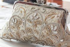 Ecru beaded bridal clutch with elegant embroidery