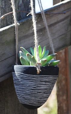 Horizon Line Design Black and White Hanging Succulent Planter with Natural Rope. $25.00, via Etsy.