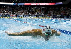 July 2, 2016; Omaha, NE, USA; Michael Phelps during the men's 100m butterfly finals in the U.S. Olympic swimming team trials at CenturyLink Center. Mandatory Credit: Rob Schumacher-USA TODAY Sports TPX IMAGES OF THE DAY ORG XMIT: USATSI-274076