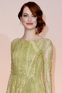 "Hairstylist Mara Roszak took Emma Stone's hair in a ""whimsical, 1930s"" direction with pinned-up S-waves.    - HarpersBAZAAR.com"