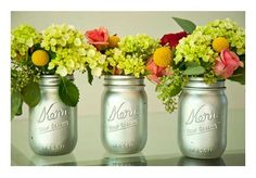Metallic Vases - Use a mason or other glass jar, and give it two coats of rust-proof silver spray paint.  Dry overnight and fill with flowers :-)