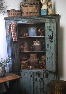 Chippy wood cupboard with nice collection.