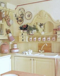 Cottage Style - like the idea of taking an old dresser mirror and hanging it above the sink