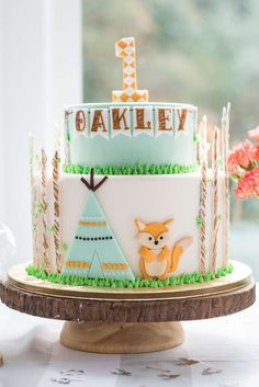 Absolutely love this gorgeous Woodland Birthday cake!! The decorations are adorable!! Love the tent and little fox! See more party ideas and share yours at CatchMyParty.com