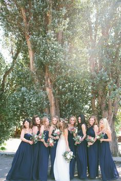 Navy Bridesmaid Dresses. Unique Wedding Dress. Flower crown.  Wedding pictures.  Condor's Nest Ranch.  Leah Vis Photography