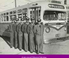 """Six bus drivers in uniform, Milwaukee, Wisconsin, 1952. According to the Milwaukee Public Library's catalog entry, the photographer's note with this photo says: """"Milwaukee's first Afro-American busdrivers."""" Photo by Fred R. Stanger."""