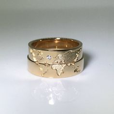 World map wedding bands. His and hers wedding rings set. Matching wedding bands. Wedding rings.