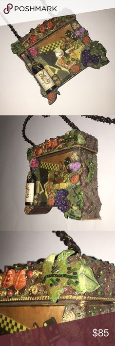 """Mary Frances 3470 purse handbag wine bottle decor 3 dimensional boxy purse with wine bottle/ glass theme. One leaf on lid has some damage but overall great condition. Great item for the Mary Frances collector. 24"""" drop chain strap.  Approx 5 1/2""""x 6""""x 2"""" Mary Frances Bags"""