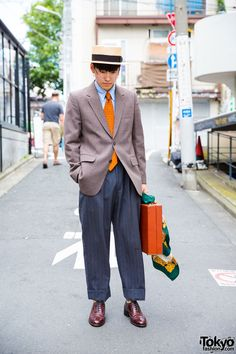 Masu on the street in Harajuku wearing a vintage suit with a vintage briefcase and hat by the Japanese brand CA4LA. Full Look