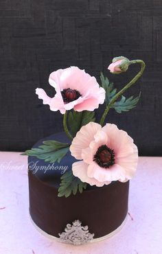 Ganached cake with poppies  by SweetSymphony