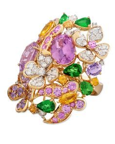 Margot McKinney ~ Flower and Butterfly ring set with violet spinels, sapphires, diamonds and tsavorites in 18k gold.