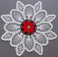 Crochet Pattern for Poinsettia Pineapple Doily Crochet PatternThere is never a bad time to create holiday before the Christmas around each year. Christmas is often considered the most festive holiday, with many options available for Christmas crochet patterns that will add to your home decor. The Poinsettia Pineapple Doily is one
