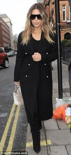 Kim Kardashian wraps up in an elegant all-black ensemble as she jets out of London | Mail Online