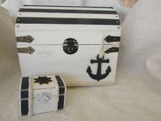 Original nautical wedding card box and Matching ring box White with Charcoal stripes anchor wheel Rope. This listing is for 1 nautical wedding card box and 1 ring bearer pillow alternative box as seen in the pictures. These boxes have all been stained white inside and outside and has charcoal stripes with white rope. On the Card box is a charcoal anchor with white rope. On the ring box is a charcoal ships wheel and white ropes. These are my own original designs. THe card box measures 8…