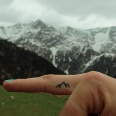 This sweet tiny tattoo of mountains is a good reminder to all of us to get outside and have some fun, as Serena, the tattoo's owner says. I love