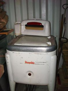 Wringer type washing machine. My mother had one when I was a little girl.