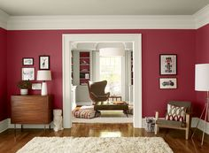 Benjamin Moore Paint Colors - Red Living Room Ideas - Upbeat, Berry-Red Living Room - Paint Color Schemes . . . . . Choose a berry tint to convey an upbeat, youthful vibe. . . . . . Walls & Shelf Insets (walls in 1st room, shelf insets in 2nd room) - Sultan's Palace (2081-20); Ceiling & Bookshelf (ceilings in both rooms, bookshelf & walls in 2nd room) - Baby Fawn (OC-15); Trim (both rooms) - Cloud White (OC-130).