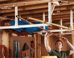 Overhead Storage in the Garage - Stow bulky items overhead by cementing together a simple rack from PVC pipes and fittings. Bolt the straight pipe to the ceiling joists to support heavy loads, and screw the angled pieces from the