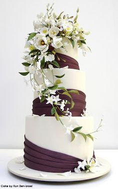 I like the iced ribbon and the fresh flowers on top!