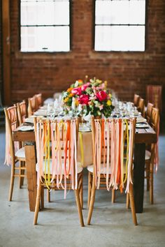 Tie colorful ribbons on the back of your chairs. | 20 Foolproof Hacks For Throwing The Perfect Dinner Party