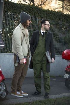 The strongest street style at Milan fashion week  Picked this for the dude w/the hat not the painter on the right JL :)