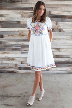 Our Russian Doll Dress features a scoop neckline, chest, arm, and hem embroidery, and side inset pockets. - 100% Cotton Lined - 100% Rayon - Hand wash cold, hang or line dry Size & Fit Fit: This garme