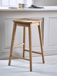 Generously sized with a bold square frame and visible wood grain details, this beautifully crafted stool is the perfect way to make a feature of your breakfast bar. It has slim, tapered legs and a handy footrest, perfectly placed for comfort. Its natural laquered oak finish will suit any style of kitchen.