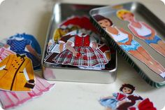 38 uses for tin boxes (e.g. Altoids).  This magnetic dress up doll set would be a good surprise toy when traveling (plus it's small -- great for carry-ons!).