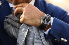 Chopard Mille Miglia. Great watch, though with such a nice jacket I'd have opted for a leather strap. Moot point because this guy is probably swimming in women as we speak :/